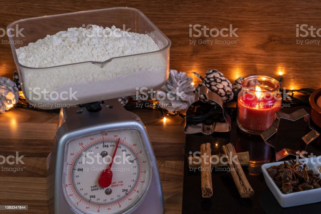 Weighing flour to make gingerbread cookies stock photo