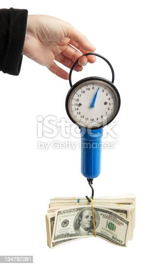 istock Weighing money with the old spring-weights 134792091