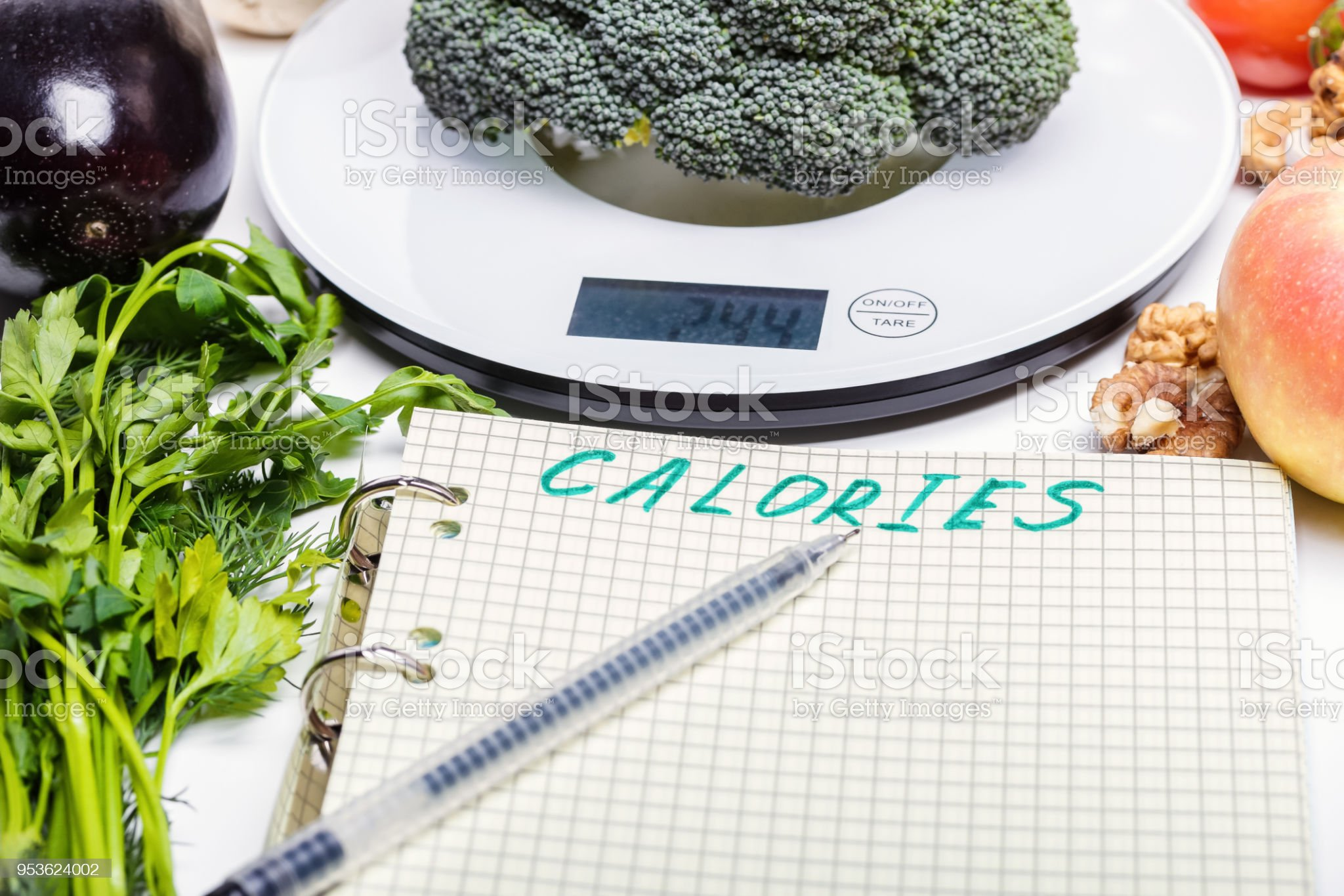 Weighing Products Vegetables Fruits On Kitchen Electronic Scales And Writing Values To The List For Calorie Counting And Making Up A Proper Diet Menu Dieting Stock Photos