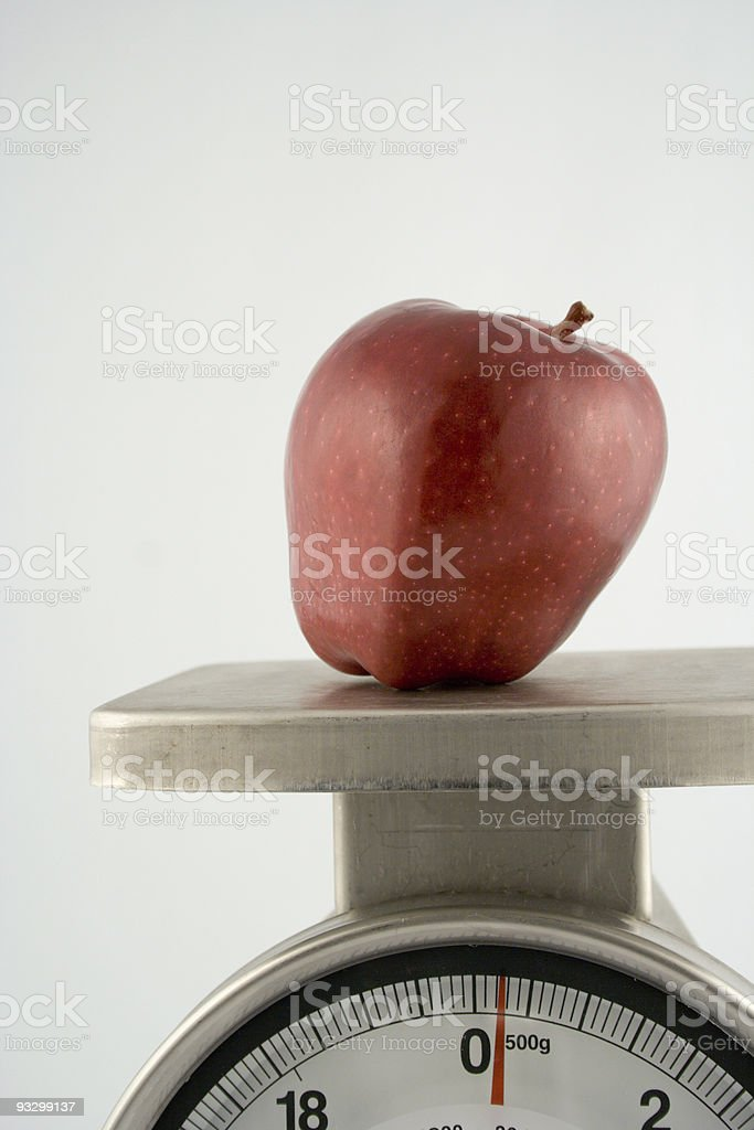 Weighing the merits of healthy eating royalty-free stock photo