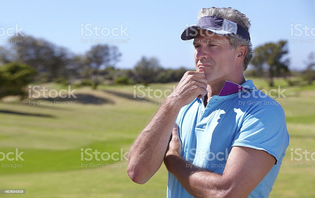 Weighing up his next shot royalty-free stock photo