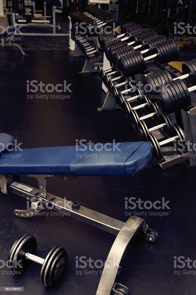 Weight Bench and Dumbbells stock photo