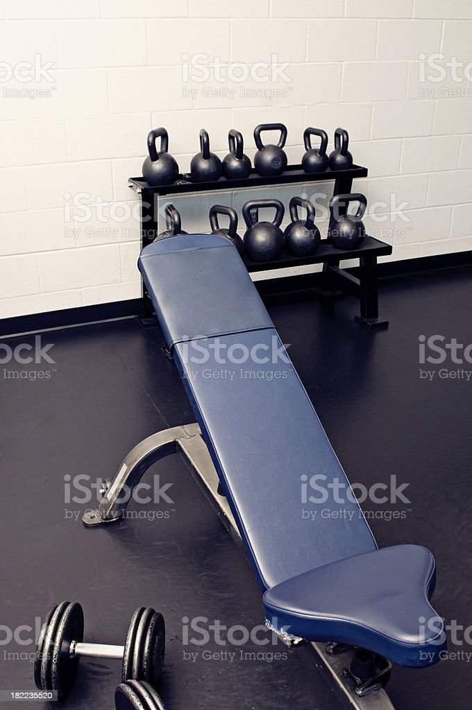 Weight Bench Dumbbells and Kettle Bells royalty-free stock photo