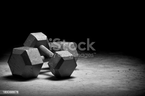 Dumbbells isolated on grunge surface. Please see my portfolio for other sport related images.