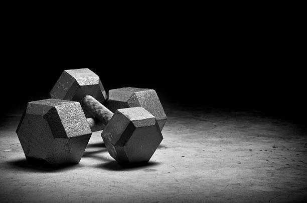 weight lifting - dumbbell stock pictures, royalty-free photos & images