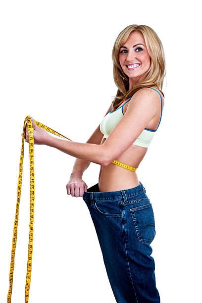 gewicht verlust-konzept - damen hosen größe 27 stock-fotos und bilder