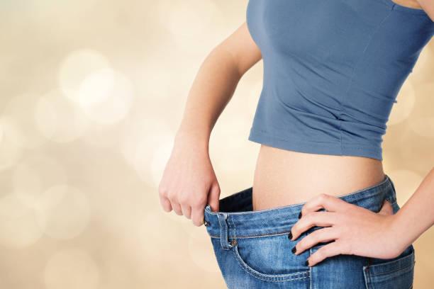 gewichtsverlust-konzept - damen sporthose übergröße stock-fotos und bilder
