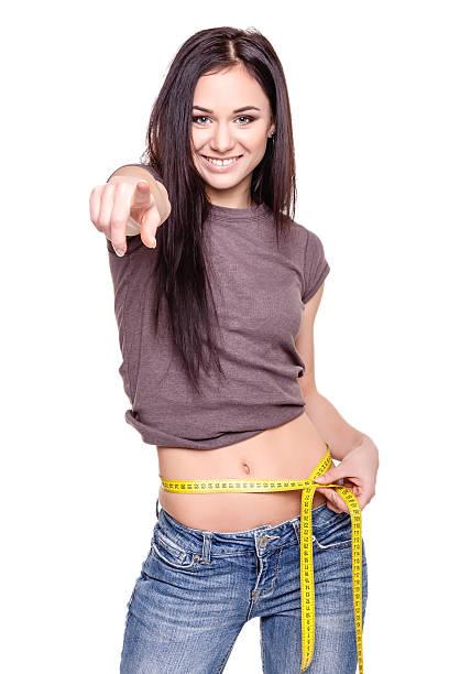 gewicht verlust-konzept-bild - damen hosen größe 27 stock-fotos und bilder