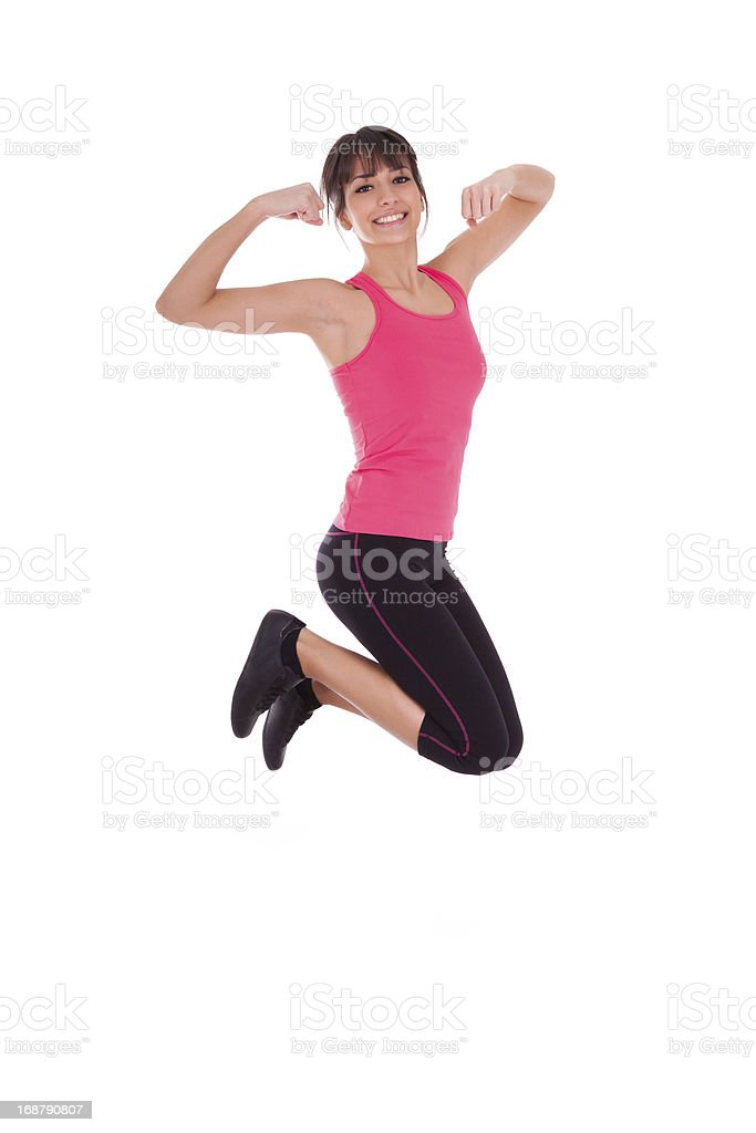 Weight loss fitness woman jumping of joy royalty-free stock photo