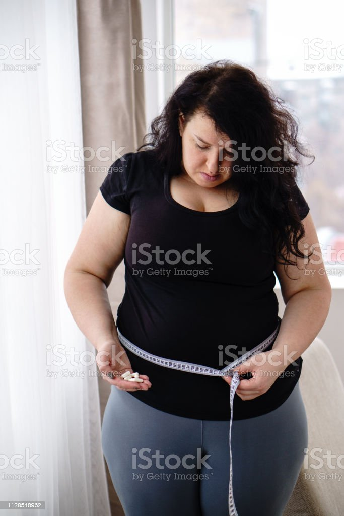 weight loss, medical therapy, diabetes prevention. Fat obese woman...