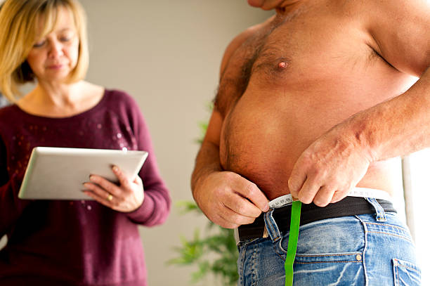 gewichtsabnahme - taillentrainer stock-fotos und bilder