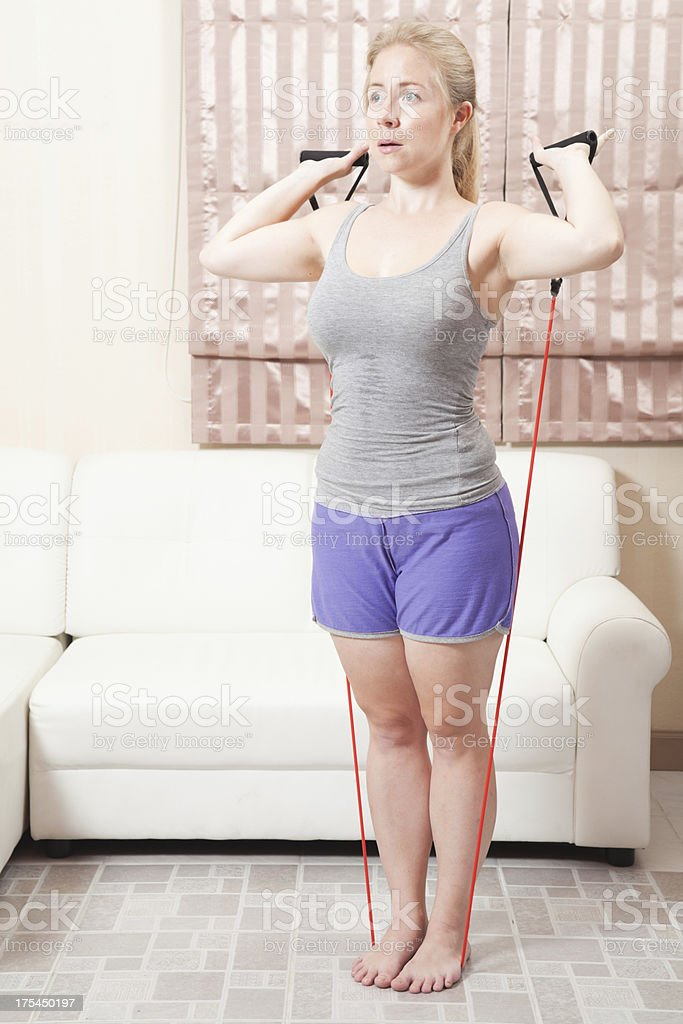 Weight loss resistance bands shoulder press exercise. Natural female model stock photo