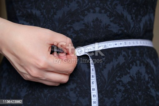 1163494373 istock photo Weight loss, slimming, diet concept 1136423982