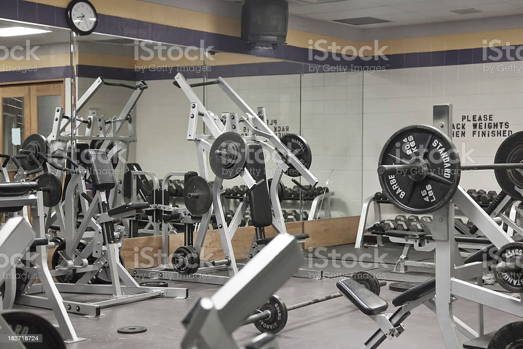 Weight room with various machines stock photo