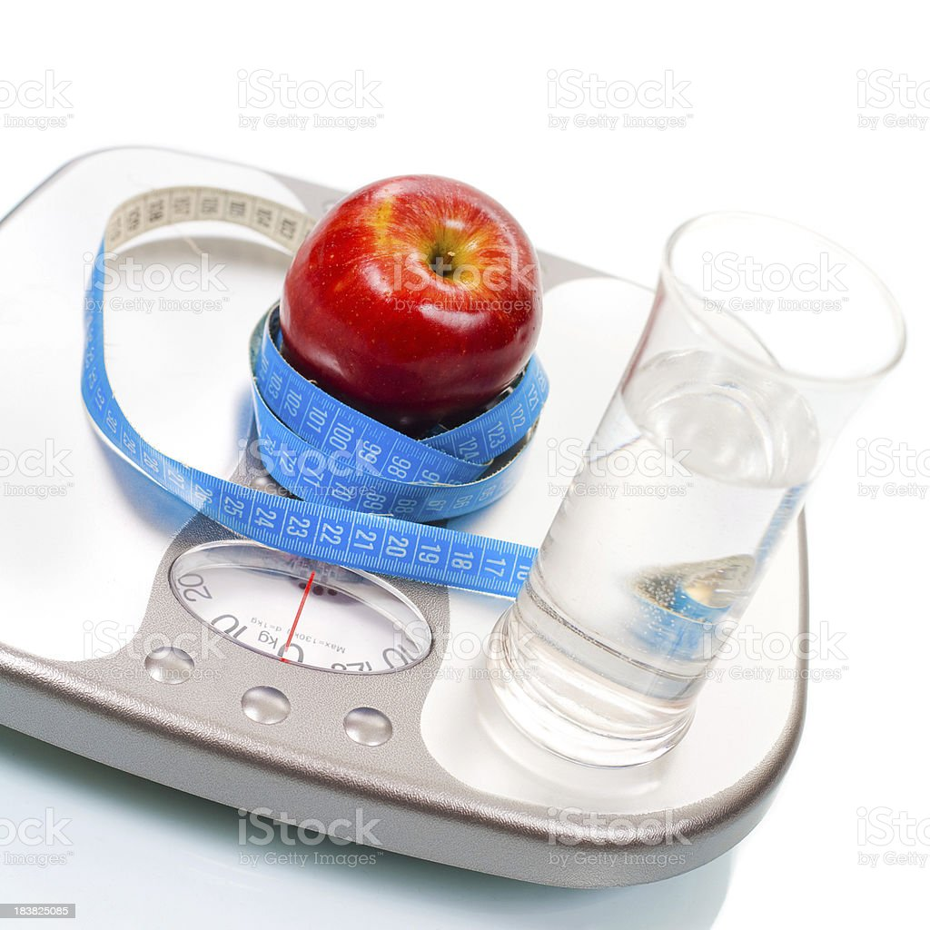Weight scale ,apple and glass of water royalty-free stock photo