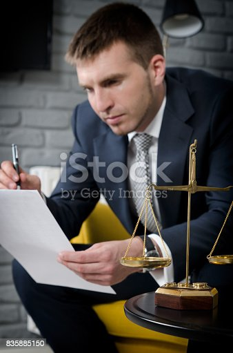 istock Weight scale of justice, lawyer in background 835885150
