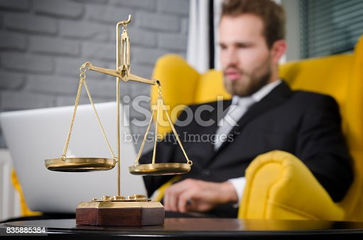 istock Weight scale of justice, lawyer in background 835885384