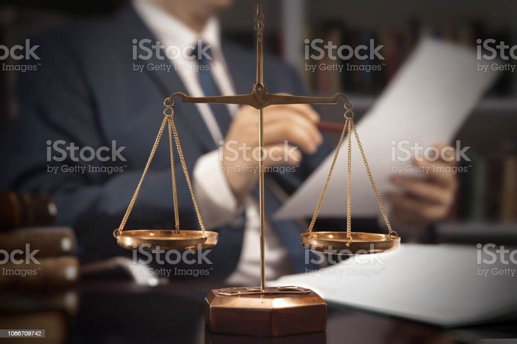 Weight scale of justice. Lawyer working in office stock photo
