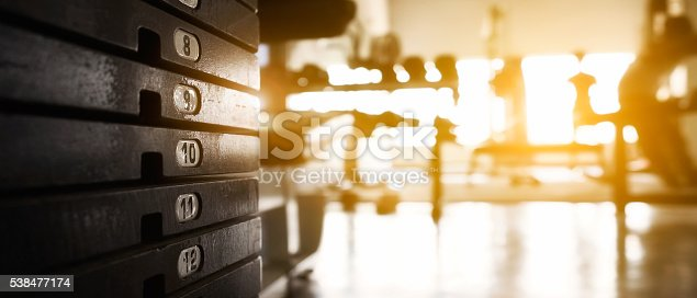 Rusty weight stack in a gym sunny day with copy space for banner presentation.