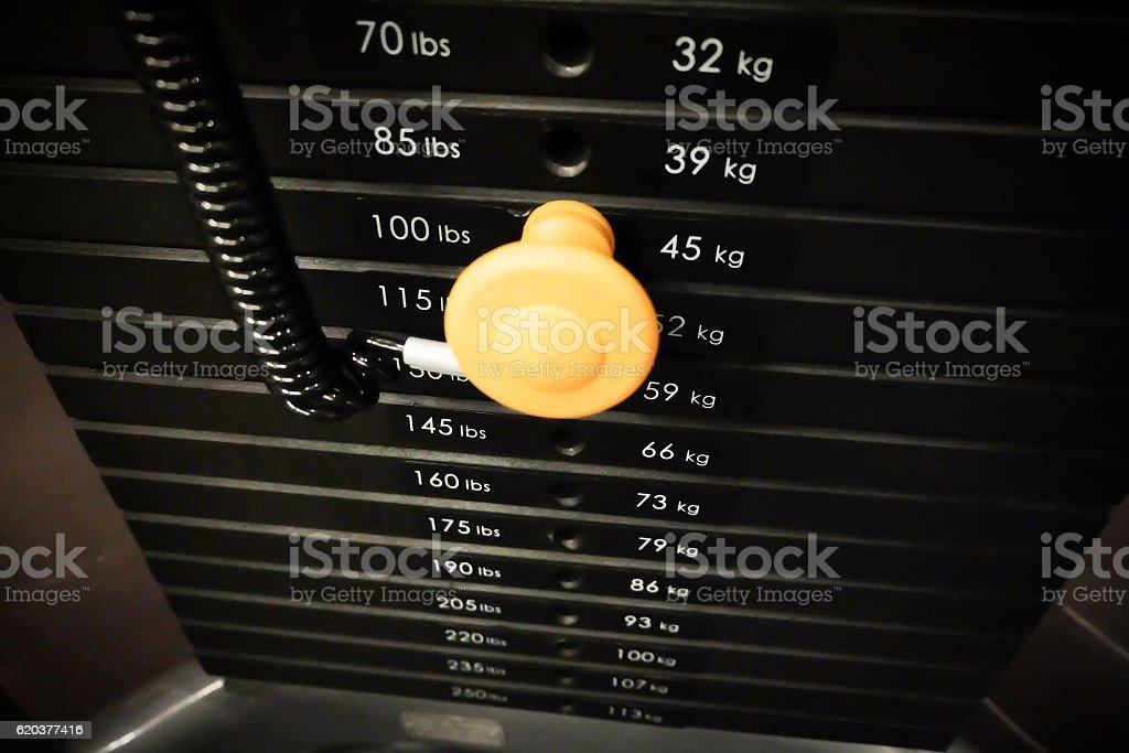 weight stack in sport club or gym and fitness room. zbiór zdjęć royalty-free