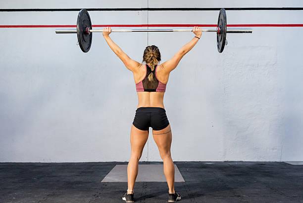 weight training at gym ! - tattoos frauen arm stock-fotos und bilder