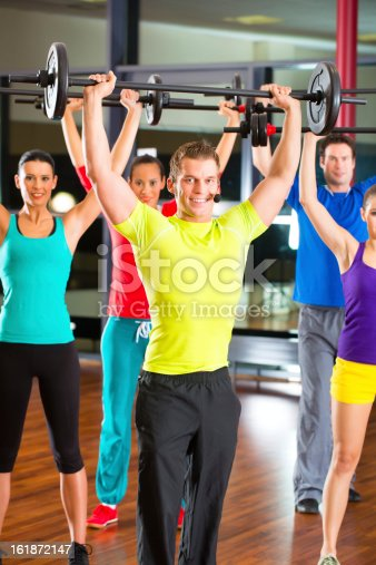 610237160istockphoto weight training in the gym with dumbbells 161872147