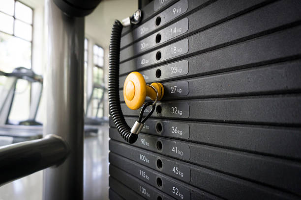 Weight Training Weight Training exercise machine stock pictures, royalty-free photos & images