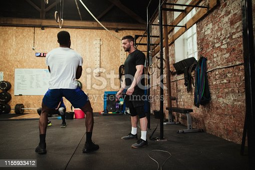 1069872470 istock photo Weight Training With a Coach 1155933412