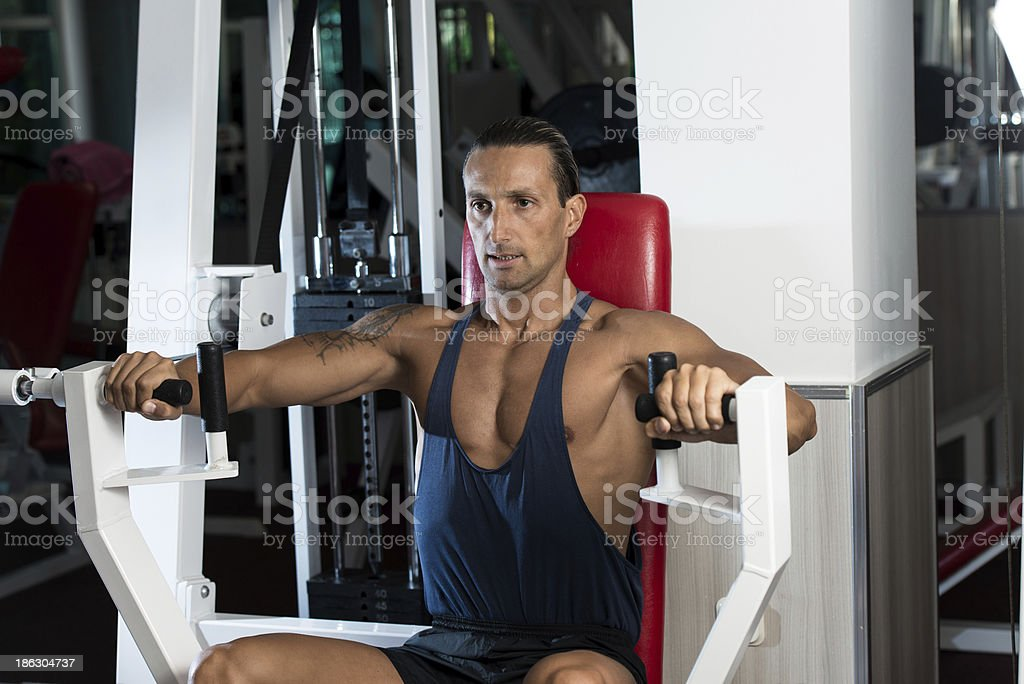 Weightlifter On Exercise Machine royalty-free stock photo