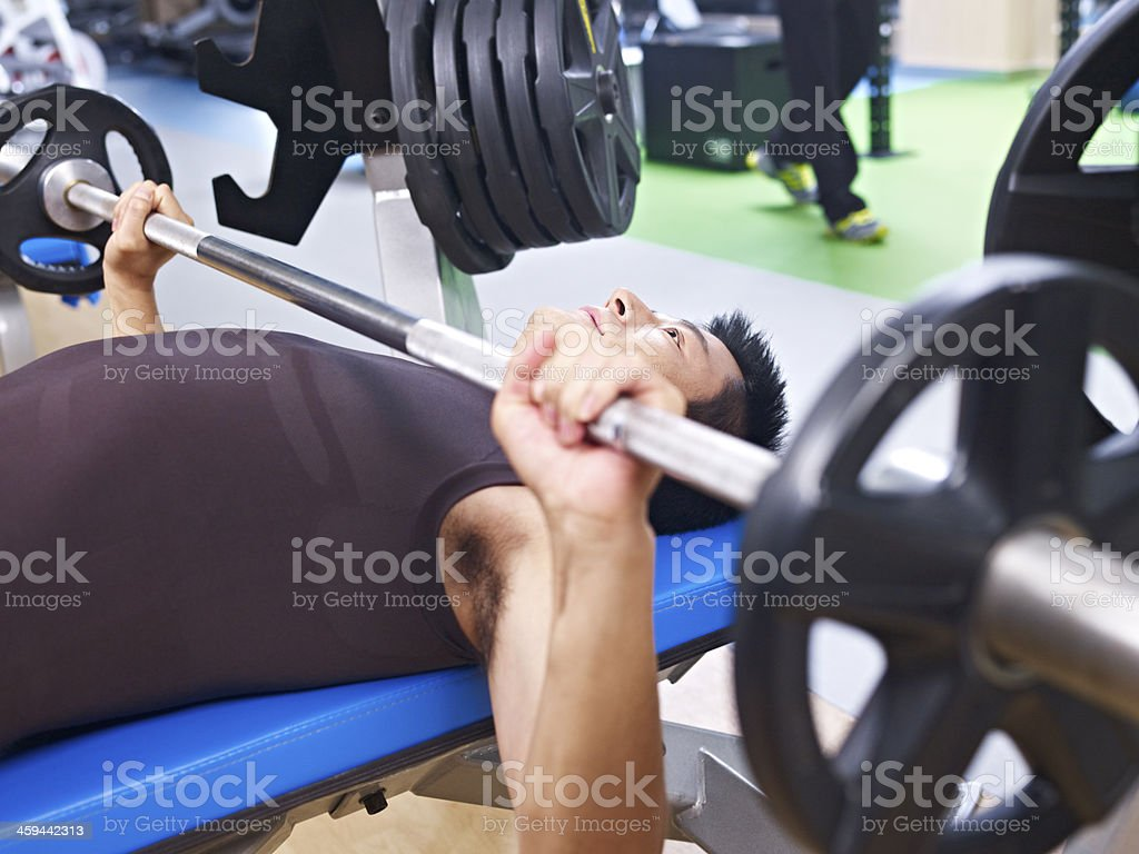 weightlifting in gym stock photo