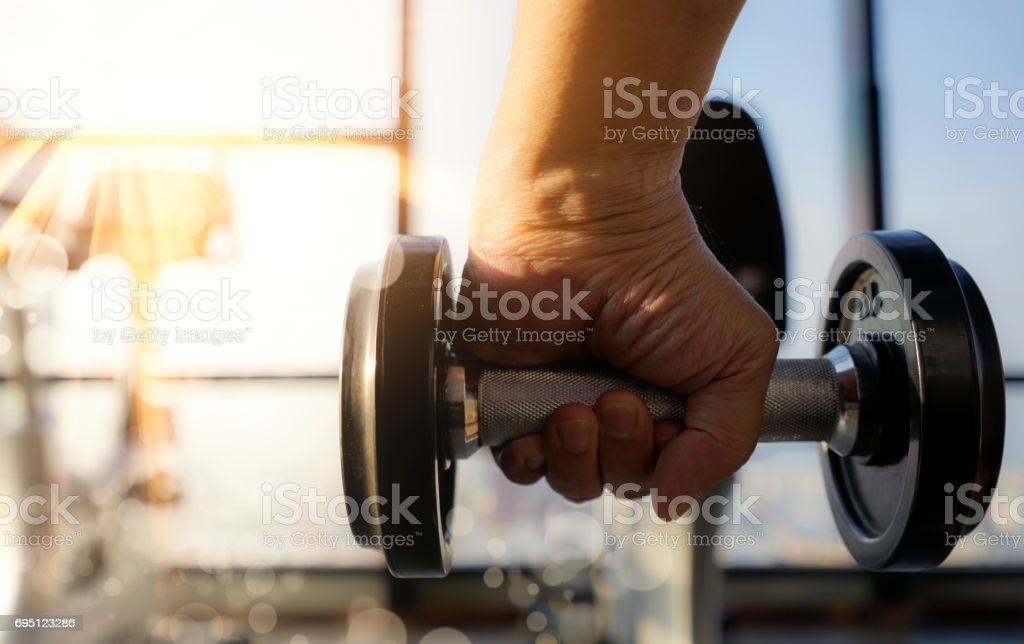 Weightlifting of dumbell in fitness room stock photo