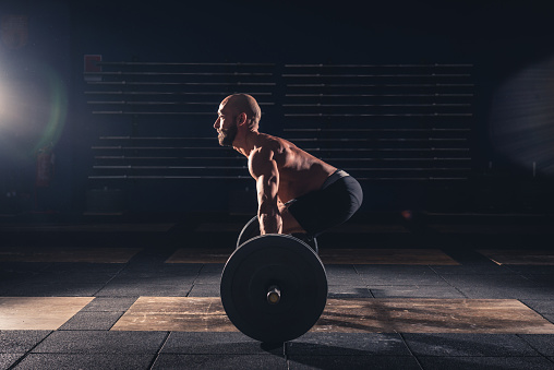 istock weightlifting strong man on a gym 538035214