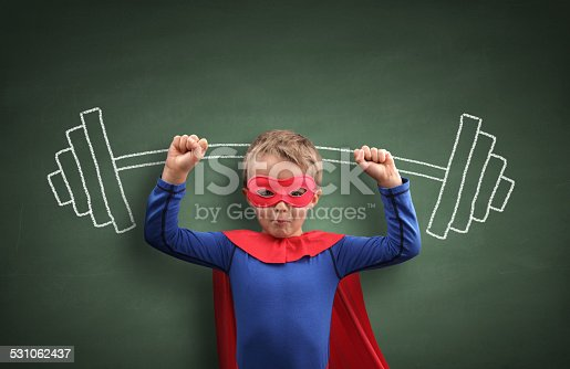 istock Weightlifting superhero boy 531062437