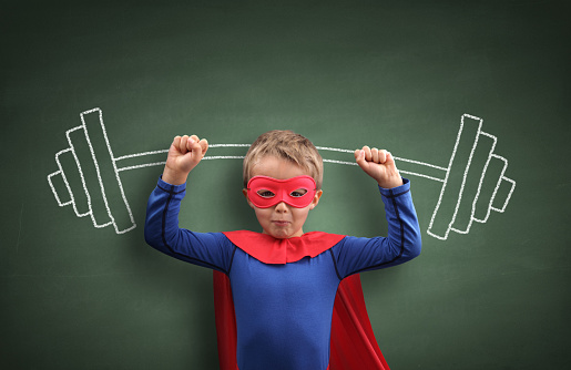 istock Weightlifting superhero boy 531062437