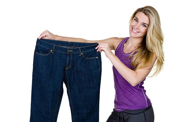 weightloss konzept - damen sporthose übergröße stock-fotos und bilder
