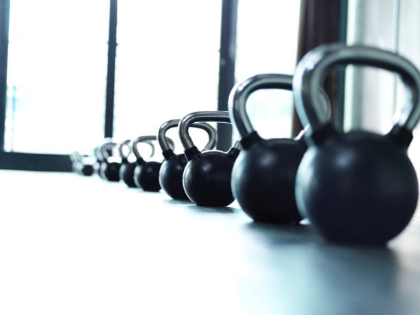 weights, they do a body good - exercise equipment stock photos and pictures