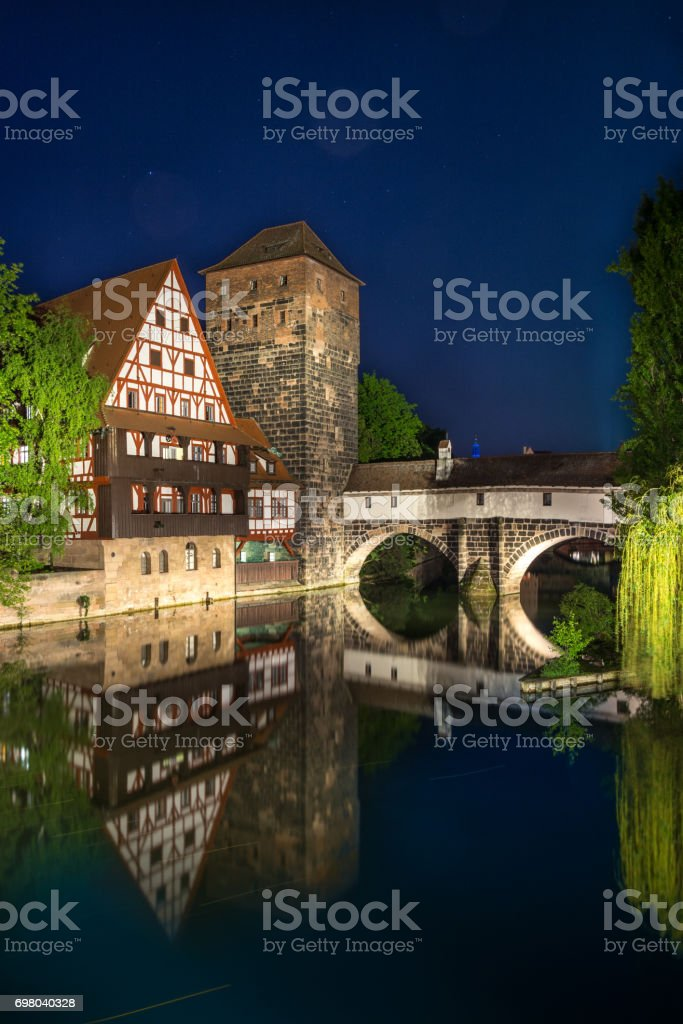 Weinstadl at the river Pegnitz in the old town of Nuremberg, Germany during blue hour stock photo