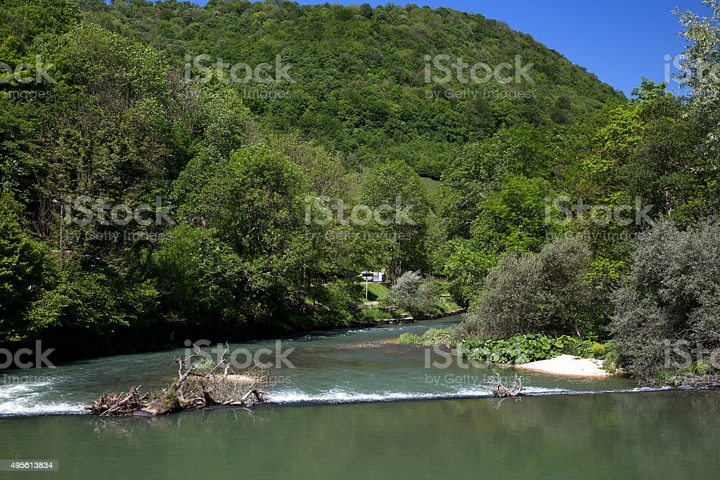 Weir in French river La Loue stock photo