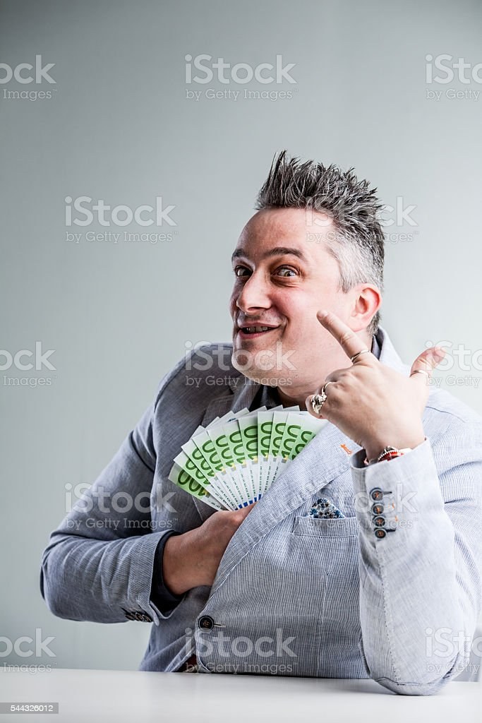 weird and bribing businessman laughing stock photo