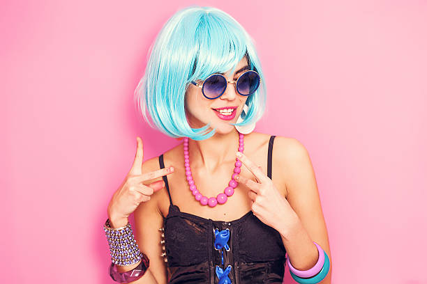 weird and funny pop girl portrait wearing blue wig - ausgefallene frisuren stock-fotos und bilder