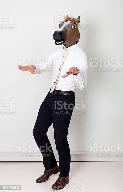 Weird businessman portrait wearing horse head and gesturing picture id525208820?b=1&k=6&m=525208820&s=612x612&h=0jhjj6kijms4rkrdvqlp l dnn4we8ny lmau 3qbni=
