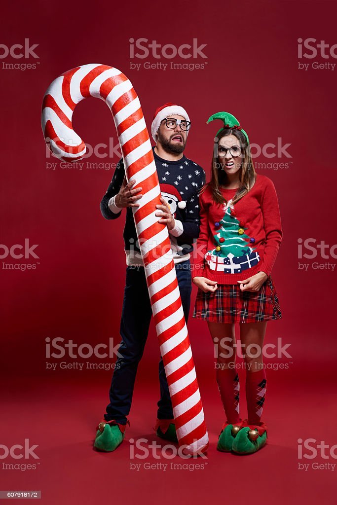 Weird Christmas couple with candy cane stock photo