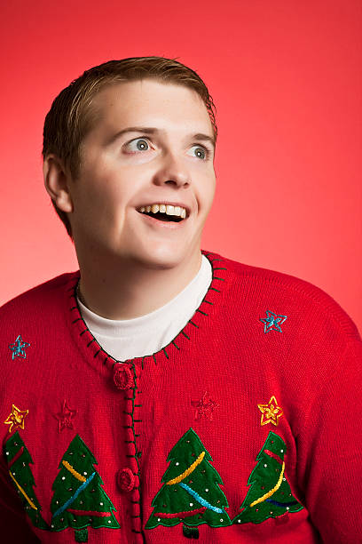 weird christmas sweater man - ugly sweater stock photos and pictures