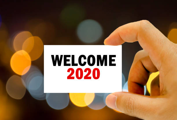 welcome 2020 on business card stock photo
