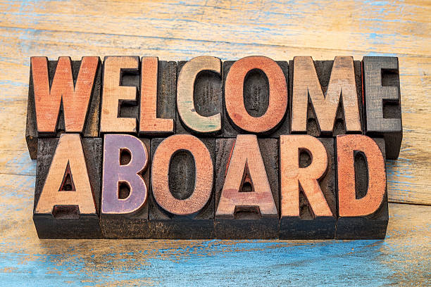welcome aboard in wood type welcome aboard sign in vintage letterpress wood type blocks stained by color inks aboard stock pictures, royalty-free photos & images