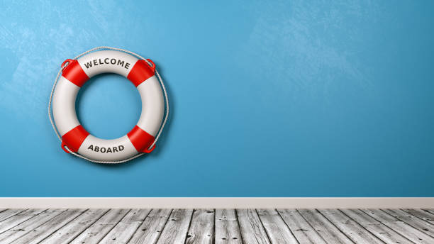 Welcome Aboard Lifebuoy Against the Wall Lifebuoy with Welcome Aboard Text in a Blue Wall Room with Copy Space 3D Render aboard stock pictures, royalty-free photos & images