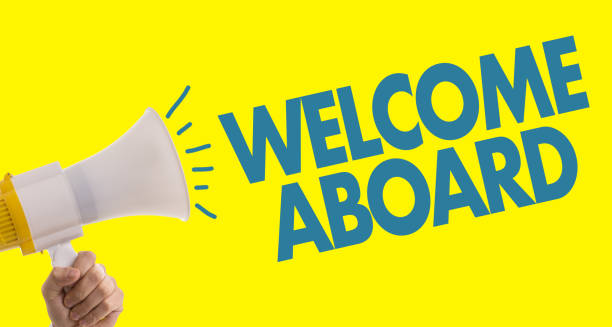 Welcome Aboard Welcome Aboard with megaphone in yellow background aboard stock pictures, royalty-free photos & images