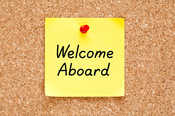 Welcome Aboard Sticky Note Welcome Aboard written on an yellow sticky note pinned on a cork bulletin board. aboard stock pictures, royalty-free photos & images