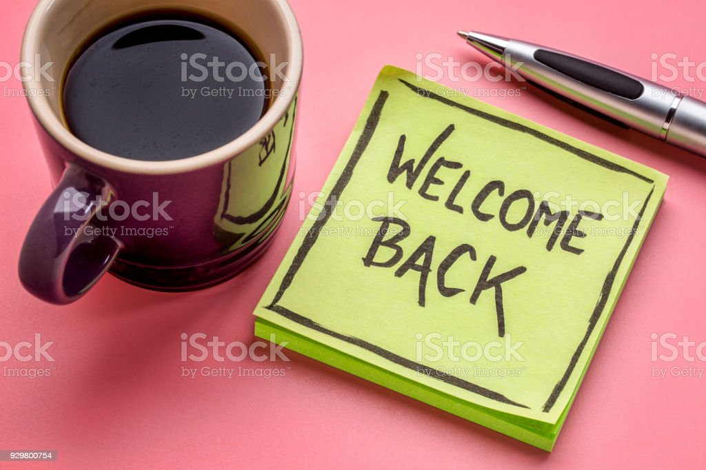 welcome back on a sticky note stock photo