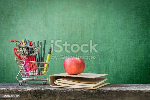 istock Welcome back to school concept with blank green chalkboard background with copy space for announcement 958607912